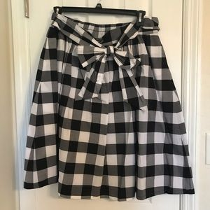Black, gray, and white plaid a-line skirt.